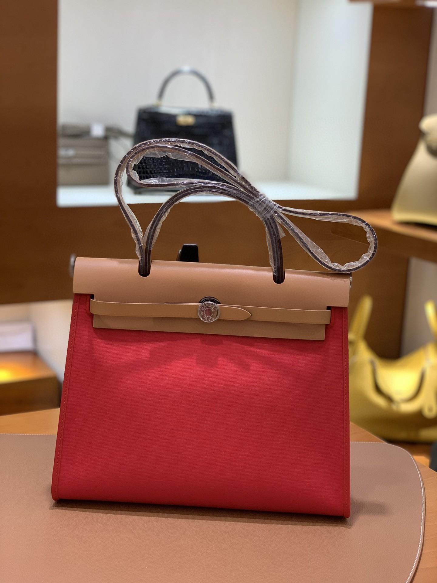 Hermès(爱马仕)Herbag 金棕色拼西瓜红 Box帆布 银扣 31cm