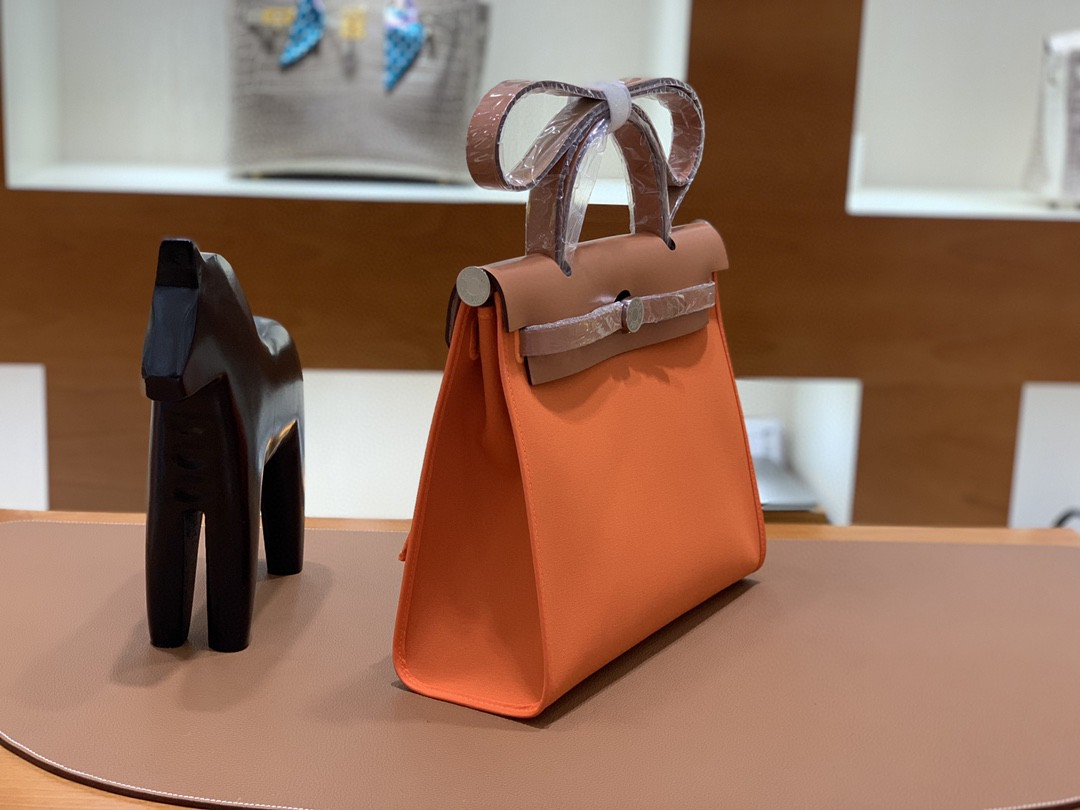 Hermès(爱马仕)herbag Box帆布 太妃金拼橙色帆布 银扣 31cm